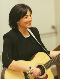 Kim Doron playing Guitar
